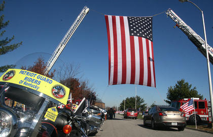 The funeral for Marion County Sheriff's Deputy Anthony Rakes was held Nov. 17 at Marion County High School. The Patriot Guard Riders' motorcycles were parked near the entrance to the school, where a large American flag A large filled an archway created by two fire trucks.