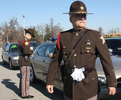 Deputy Mark Beatley, right, and Deputy Brian McWilliams of the Marion County (Ind.) Sheriff's Department prepare to enter Marion County High School to pay their respects to Deputy Anthony Rakes.