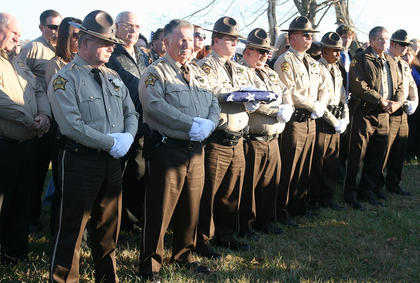 Members of the Marion County Sheriff&#039;s Department honor their fellow officer at the Old Liberty Cemetery.