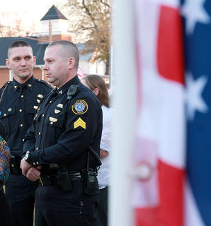 Columbia Police Chief Jason Cross, left, and Sgt. Junior Murphy were among the many visitors who  stopped by Bosley Funeral Home Friday evening.