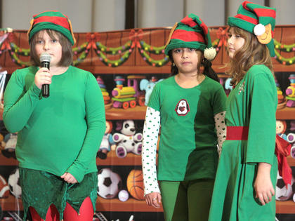 Elves Fred (Josie Benninngfield, left), Hustle (Aleli Huerta, center) and Bustle (Sarah Followell) make things more difficult for Randy.