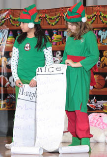 Hustle (Aleli Huerta) and Bustle (Sarah Followell) make sure the naughty and nice lists are ready to go.