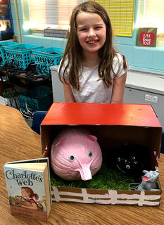 """West Marion Elementary School student Rowan Cecil is pictured with her Wilbur-themed pumpkin fromthe book """"Charlotte's Web."""""""