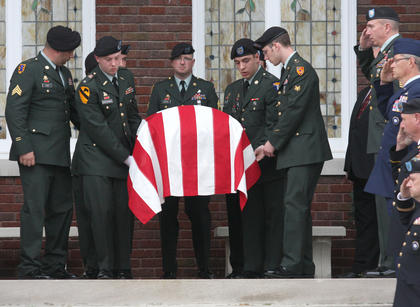 Pallbearers from the Kentucky National Guard carried Sgt. Sigley&#039;s coffin out of Lebanon Baptist Church.