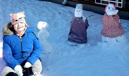 Pictured is Isabella Gabehart with her snowmen and women.