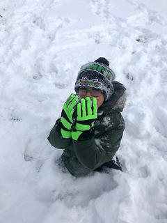 Cash Bickett has a snow snack on Tuesday, Jan. 16.