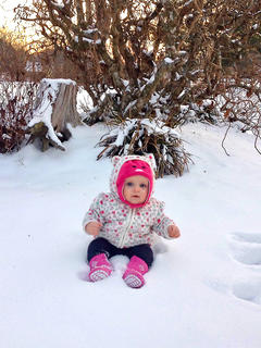 Adalynn Rakes enjoys her first snowfall. Photo submitted by Emily Clark.