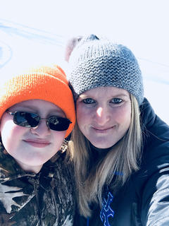 Brandon Estes and is mother Tammy Sipes enjoy the snow together last week.