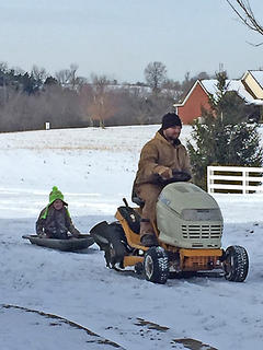 Pictured are Tom Farris and Chazity Farris playing in the snow.