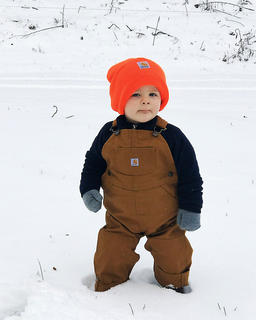 Fourteen-month-old Thomas Bland isn't quite sure what to think about the snow, but he looks awfully stylish.