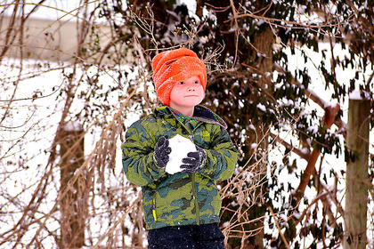 Four-year-old Liam Hardin prepares to throw a snowball.