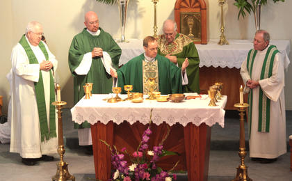 Rev. Charles Thompson, the bishop of Evansville (Ind.), offers a prayer of blessing.