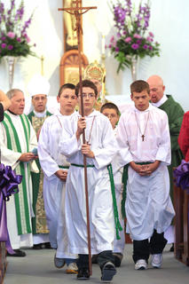 At the end of the Mass, the servers lead the procession out of church.