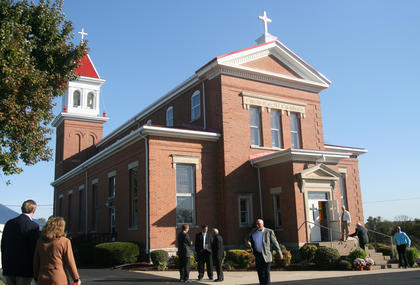 Parishioners and visitors enter St. Charles Catholic Church on Oct. 16. The church celebrated its 225th anniversary this weekend.