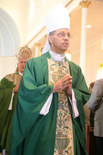 Rev. Charles Thompson, the bishop of Evansville (Ind.), exits the church. Thompson is a Marion County native who attended school at St. Charles.