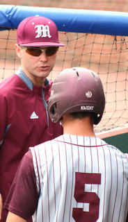 Pitching coach Marc Brock talks with pitcher Andrew Spalding between innings.
