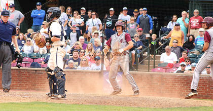 Dalton Hammond reacts after scoring the go-ahead runjust ahead of the tag in the eighth inning.
