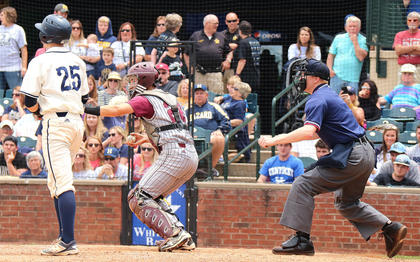 Catcher Cody Browning reacts as home plate umpire David Andersoncalls strike three on the batter.