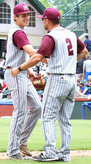Pitcher Luke Thomas shakes hands with Head Coach Patrick Campbell after recording the final out of the game for the win.