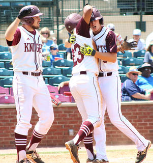 Cameron Nalley and Andrew Spalding celebrate the homerun as Travis Wiser looks on.