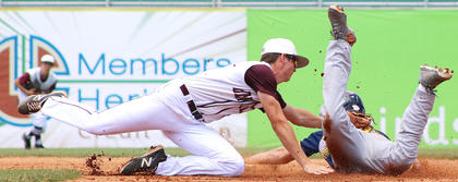 Shortstop Andrew Spalding tags out Knox Central's Dane Imel as he attempts to steal second base.