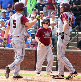 Andrew Spalding is congratulated at the plate after his solo homerun by Travis Wiser and batboy Sy Bramblett.