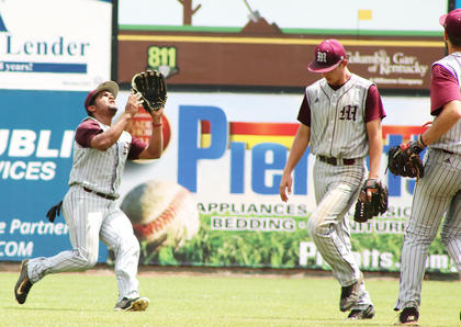 Center-fielder Cameron Nalley charges in to catch a pop-up.
