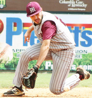 Shortstop Travis Wiser slides to make a play on a sharp ground ball in the fifth inning.