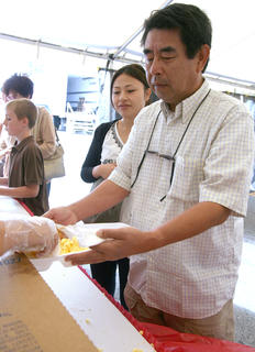 Hiroyuki and Manami Nishioka make a trip through the breakfast line on Sunday.
