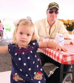 Clara, 2, sits for breakfast with her father, Jerry Bartley of Springfield.