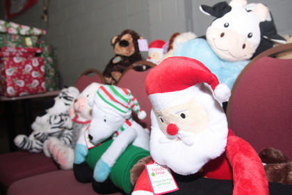 More than 50 children received gifts Dec. 22 at the Cardinal Den. The Generation Gap hosted its annual toy giveaway, and Santa Claus stopped by to help distribute the gifts. Every child received a toy and bag with fruit and a candy cane. Since every child received a gift, the leftover presents were donated to Kosair Children&#039;s Hospital.