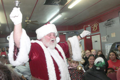 Santa Claus arrived and lead a rendition of &quot;Jingle Bells.&quot;
