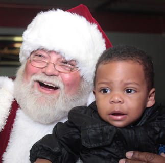 Motreze Churchill, 1, wasn't as happy as some of the other children to pose with Santa.