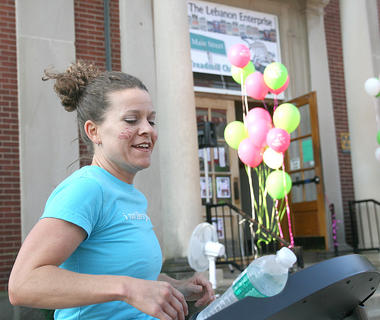 Lebanon Enterprise Publisher Stevie Lowery kicks off the Main Street Treadmill Challenge.