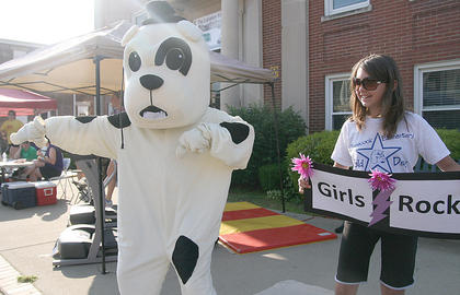 The Glasscock Elementary Bulldog dances up a storm alongside Jasmine Benningfield.