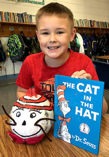 """West Marion Elementary School student Tristen Hamilton is pictured with his """"The Cat in the Hat"""" pumpkin."""
