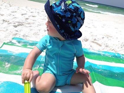 Sam Truitt, 1, enjoys his first trip to the beach in Okaloosa Island, Fla.