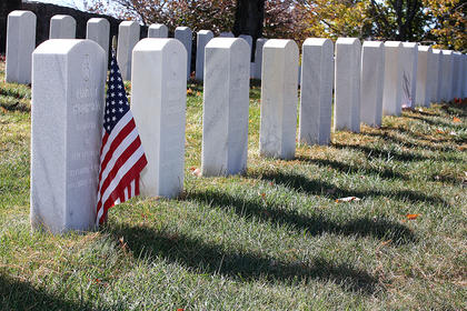 A single American flag adorns one of the tombstones at Lebanon National Cemetery in honor of Veterans Day, which is celebrated on Nov. 11.