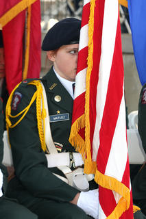 A member of the MCHS JROTC program holds the American flag during the Veterans Day ceremony.