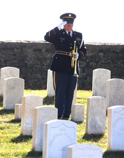A member of the Marion County Veterans Honor Guard salutes the flag after playing TAPS during a Veterans Day ceremony Nov. 7.