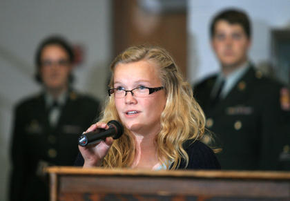 Hattie Clark sings the national anthem during the Veterans Day program.
