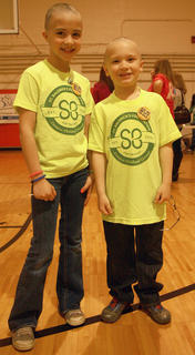 Siblings Brianna and Landon Knopp pose for a photo after their haircuts.