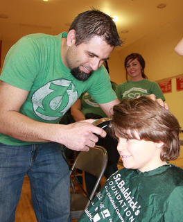 Eric Daugherty gets a chance to shave part of his son's head. Owen raised more than $1,500 for St. Baldrick's.