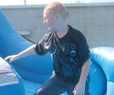 Jacob Stewart, 8, finishes a trip down the slide.