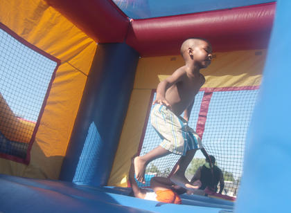 Tylin Spalding, 3, leaps on the bouncy.