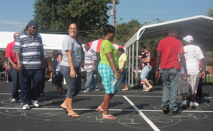 The kids weren't the only ones having fun at the Youth Explosions. Adults take part in a cake walk.