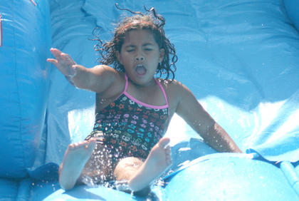 Aliah King, 8, takes a turn on the water slide during First Baptist Church&#039;s Youth Explosion on Aug. 20.
