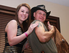 "<div class=""source"">Stephen Lega</div><div class=""image-desc"">Hannah Wilson rubs Ernie ""The Turtleman"" Brown's tattoo for good luck during her send-off Friday. Wilson will represent Marion County in the 2013 Distinguished Young Woman of Kentucky program Jan. 11-12.</div><div class=""buy-pic""><a href=""/photo_select/24875"">Buy this photo</a></div>"