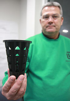 """<div class=""""source"""">Stephen Lega</div><div class=""""image-desc"""">Tim Smith, TG Kentucky functional division general manager, holds up one of the planters used to grow seedlings for the company's upcoming afforestation project.  </div><div class=""""buy-pic""""><a href=""""/photo_select/32656"""">Buy this photo</a></div>"""