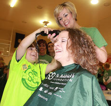 "<div class=""source"">Stephen Lega</div><div class=""image-desc"">Enterprise Publisher Stevie Lowery is the first shavee at this year's St. Baldrick's event. Her son, Owen, takes the first few swipes at her head with some help from stylist Nicole Thompson. </div><div class=""buy-pic""><a href=""/photo_select/33169"">Buy this photo</a></div>"